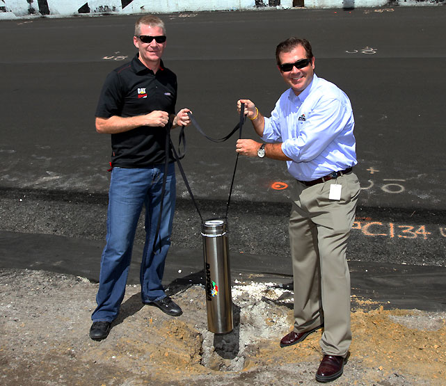 Current Sprint Cup driver Jeff Burton (left) helped Chitwood bury a time capsule under the start/finish line. Included in the time capsule are pieces of Daytona history and memorabilia, a Blackberry, model cars and a piece of the concrete patch from the infamous pothole that red-flagged February's Daytona 500.