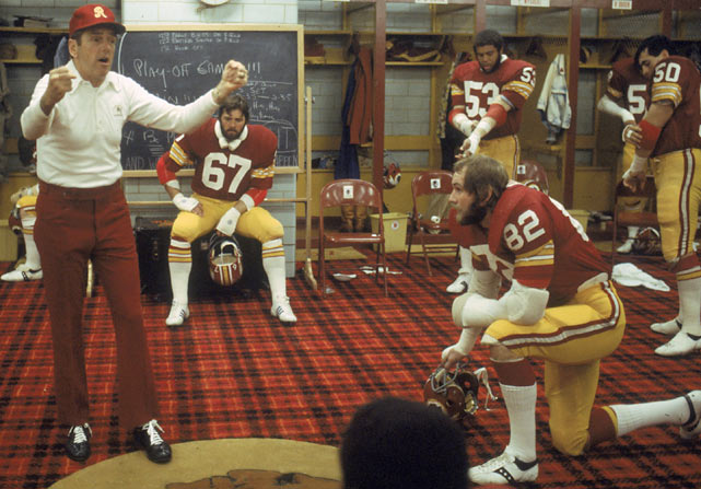 George Allen, looking ever-so-stylish, talks to the Redskins. Notice the plaid carpet. Pretty amazing.