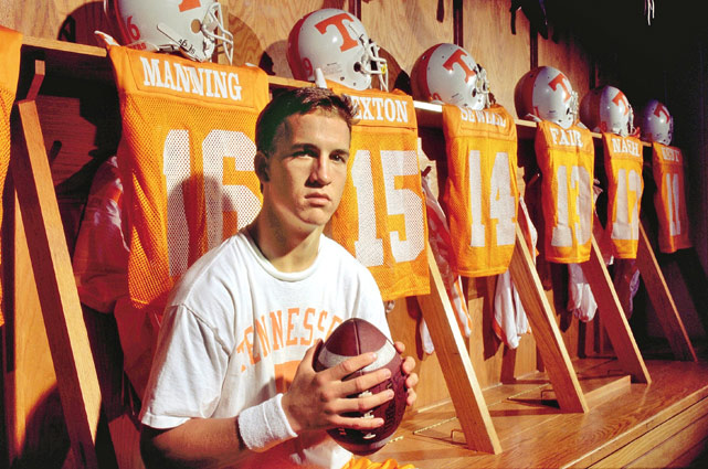 Peyton Manning, who looks like he's 12, poses in the Tennessee locker room in 1995.