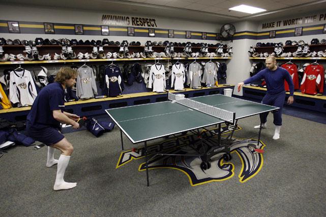 Peter Forsberg (left) plays ping-pong against Tomas Vokoun in the Nashville Predators' locker room.