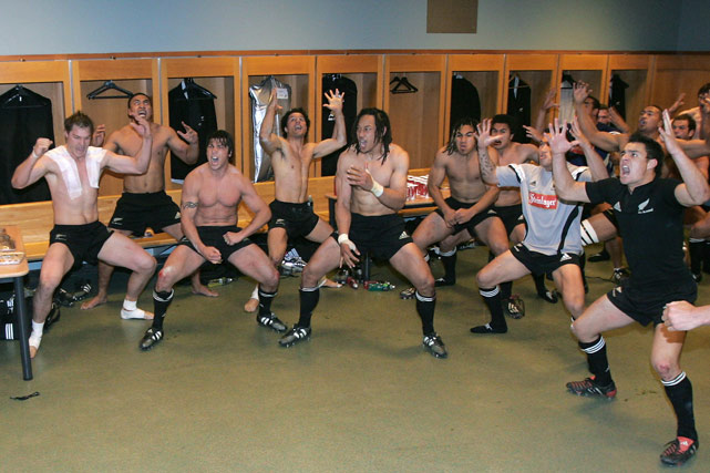 New Zealand team players perform their Haka after winning their rugby test-match against France in 2004.