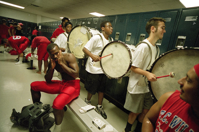T.C. Williams' High School (Va.) band members march through the football locker room before heading to the field.