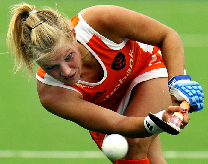 Netherlands' Sophie Polkamp passes the ball during a field hockey match against India at the Women's World Cup 2010 in Rosario, Argentina.