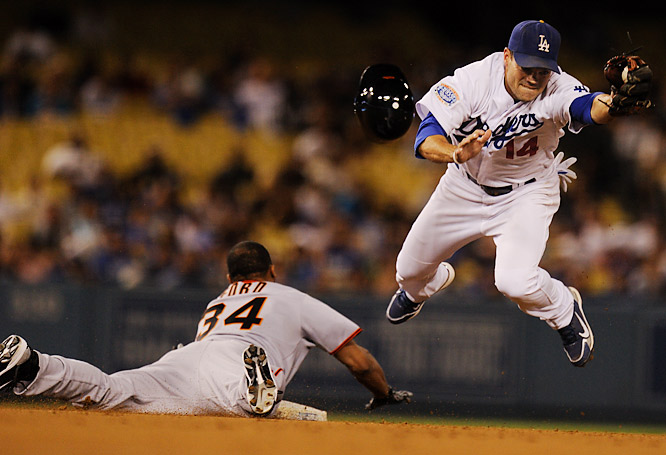 Jamey Carroll of the Los Angeles Dodgers is pulled off the bag as Darren Ford of the San Francisco Giants steals second in the eighth inning on Sept. 4. The Giants came back to win 5-4.