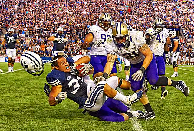 BYU running back Bryan Kariya got a less obstructed view of Washington linebacker Cort Dennison after a helmet-jarring hit by end Talia Crichton. Kariya, a junior from Kaysville, Utah, ran eight times for 20 yards in the Cougars' 23--17 victory.