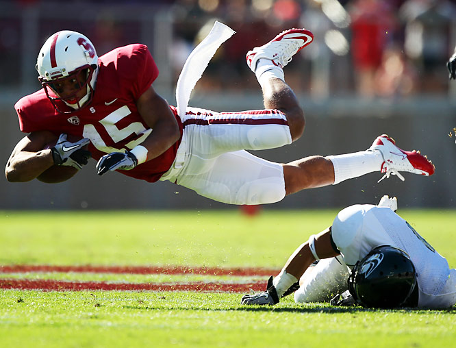 Stanford running back Usua Amanam goes airborne against Stanford in both team's season opener.
