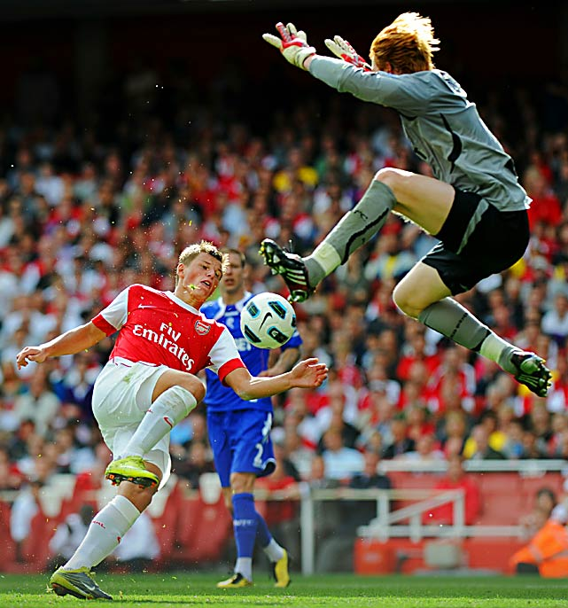 Arsenal striker Andrey Arshavin attempts a shot on goal in front of onrushing Bolton Wanderers' goalkeeper Adam Bogdam during the English Premier League match on Sept. 11 at the Emirates Stadium in London. Arsenal won 4-1.