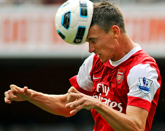 Arsenal defender Laurent Koscielny heads the ball clear during a 4-1 victory over Bolton Wanderers on Sept. 11 in the English Premier League.