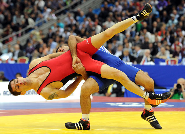 Venelin Vankov (red) of Bulgaria vies with Roman Amoyan of Armenia during their 55 kg Greco-Roman matchup Sept. 6 at the World Wrestling Championships in Moscow. Amoyan took third place.