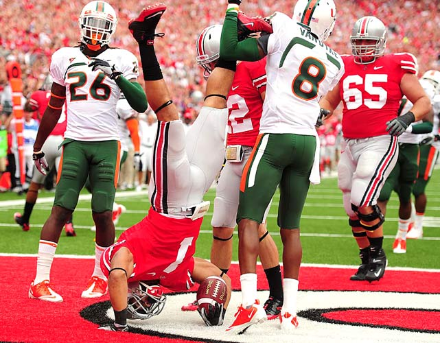 Ohio State Buckeyes running back Dan Herron does a handstand after diving in for a touchdown against the Miami Hurricanes on Sept. 11 at Ohio Stadium in Columbus. Ohio State defeated Miami 36-24.