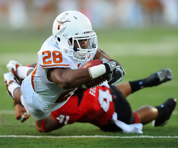"Texas running back Foswhitt ""Fozzy"" Whittaker is tackled by Texas Tech linebacker Sam Fehoko during the Longhorns' 24-14 victory in Lubbock. The junior would go on to score the first touchdown of the night."