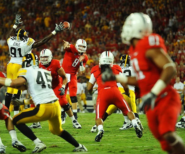 Arizona Wildcats quarterback Nick Foles gets off a pass against Iowa in Tucson on Sept. 18. No. 24 Arizona went on to beat Iowa 34-27 after a four-yard toss from Foles to William Wright with just 3:57 remaining.