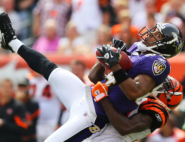 Ravens wide Receiver T.J. Houshmandzadeh pulls down a pass in front of Adam Jones of Cincinnati. The Bengals beat the Ravens 15-10 in Paul Brown Stadium.