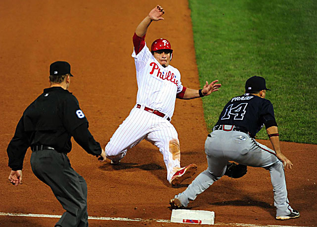 Carlos Ruiz of the Philadelphia Phillies slides into third before the ball reaches Martin Prado during the Phillies 1-0 win over Atlanta on Sept. 22.