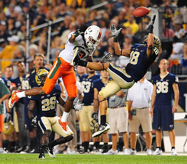 Pittsburgh Panthers cornerback Jarred Holley intercepts the ball intended for Miami Hurricanes wide receiver Travis Benjamin during their game at Heinz Field on Sept. 23 in Pittsburgh. Miami won 31-3.