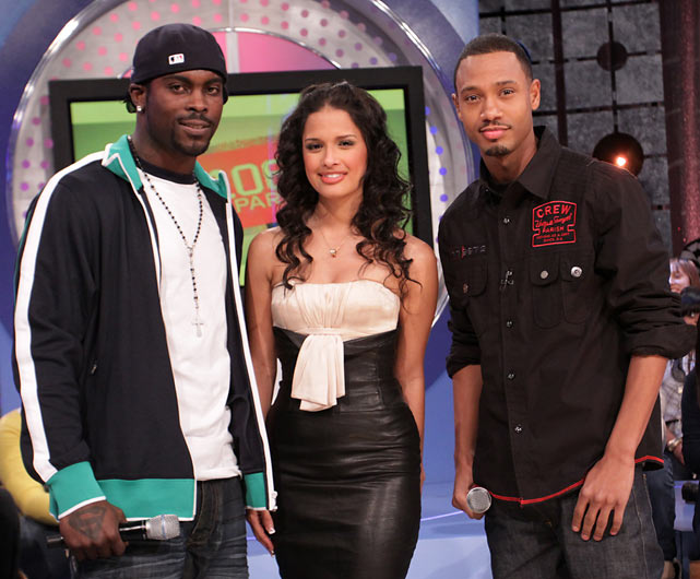 Vick visits BET's  106 & Park   and poses with hosts Rocsi and Terrence J. at the BET Studios in New York City.