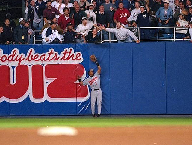 The American League pennant between the Yankees and Orioles was decided in part by a 12-year-old boy. With the Yankees down 4-3 in the eighth inning of Game 1, Yankees rookie Derek Jeter lofted an opposite field fly to deep right field. O's right fielder Tony Tarasco shuffled back to the wall to position himself to make the catch.  As the ball descended, 12-year-old fan Jeffrey Maier reached over the wall and pulled the ball into the stands. The Orioles' protests fell on deaf ears, and the Yankees went on to win the game and eventually the series.