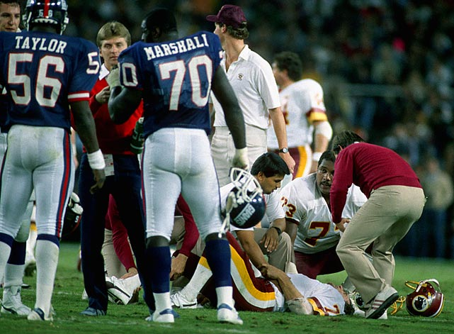 "Injuries are commonplace in the NFL.  But what made Lawrence Taylor's hit on Joe Theismann so significant was the graphic, shocking nature of it served as a reminder of the cost of playing such a violent game. In 1985, during a ""Monday Night Football"" game, Taylor sacked Theismann and immediately knew something was wrong. Taylor signaled to the sideline.  Theismann had suffered a compound fracture to his right leg; he would never play another down in the NFL."