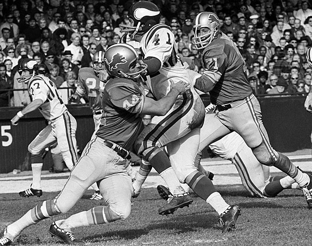 Lions defensive back Dick Lebeau (44) smothers Vikings wideout Dave Osborn during Minnesota's 30-17 victory on Nov. 1. Lebeau also added one of his nine interceptions in the losing effort, a total that was second in the NFL to only Kansas City's Johnny Robinson.