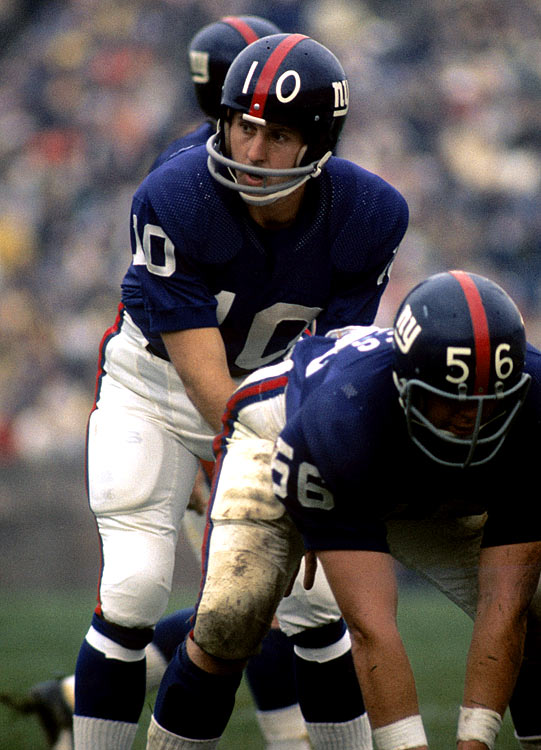 New York Giants quarterback Fran Tarkenton barks out the play call behind his offensive line. A future Hall-of-Famer and nine-time Pro Bowl selection, Tarkenton dissected opposing defenses for 2,777 passing yards while leading the Giants to a 9-5 record.