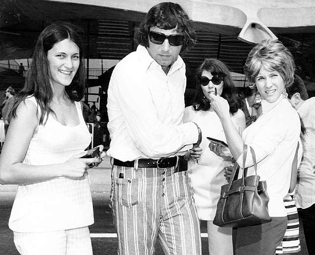 A stylish Joe Namath arrives at JFK airport in New York City to meet some of his many female admirers. While Namath was renowned for on-field heroics, he was equally notorious for his womanizing tendencies, being linked to such famous personalities as Barbra Streisand, Suzy Storm and Ann-Margret.