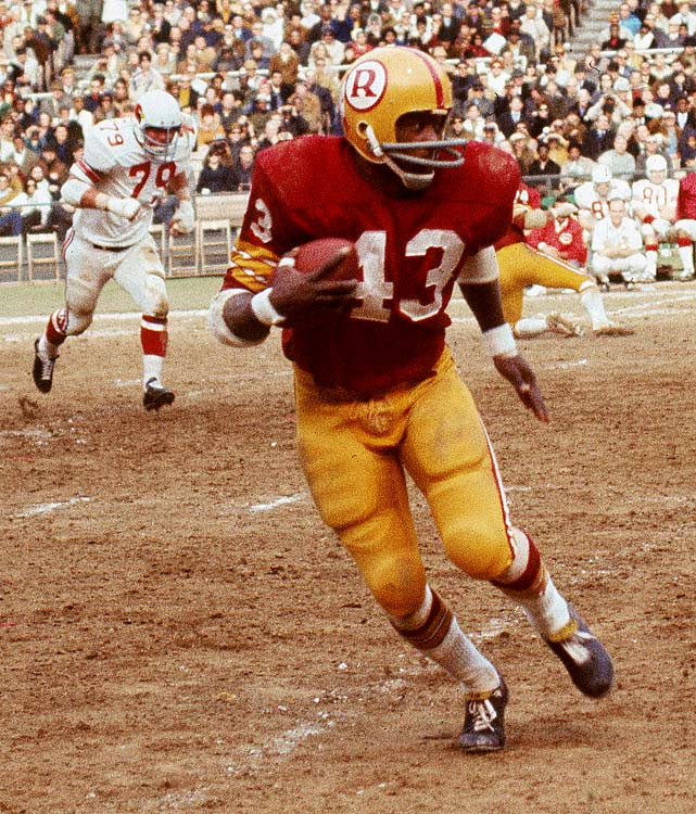 Building on a rookie campaign where he piled up 888 yards in 1969, Redskins running back Larry Brown dazzled the NFL with a league-leading 1,125 rushing yards in 1970. Here, he breaks free during a Week 14 contest with the St. Louis Cardinals, a 28-27 Washington win.
