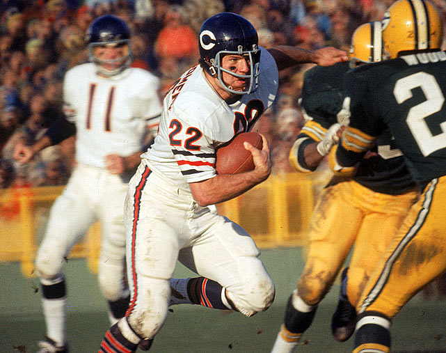Chicago Bears running back Ross Montgomery turns upfield during a Nov. 15 showdown with the rival Green Bay Packers. Montgomery carried the ball 19 times on the day, but it was Green Bay's Bart Starr who had the game's most important rush. Trailing 19-13 in the fourth quarter, Starr scampered in from three yards out to give the Packers a 20-19 victory.
