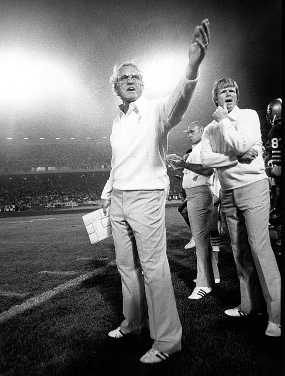 San Francisco head coach Bill Walsh mans the sidelines during a preseason matchup with the Oakland Raiders. The 49ers would finish 6-10 that year, but would improve to 13-3 in 1981 with new starting quarterback Joe Montana under center.