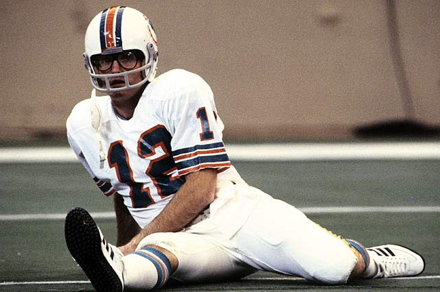 Bob Griese focuses on stretching through his thick, signature eyeglasses. After it was revealed he was legally blind in one eye, Griese started wearing the spectacles during the 1977 season.