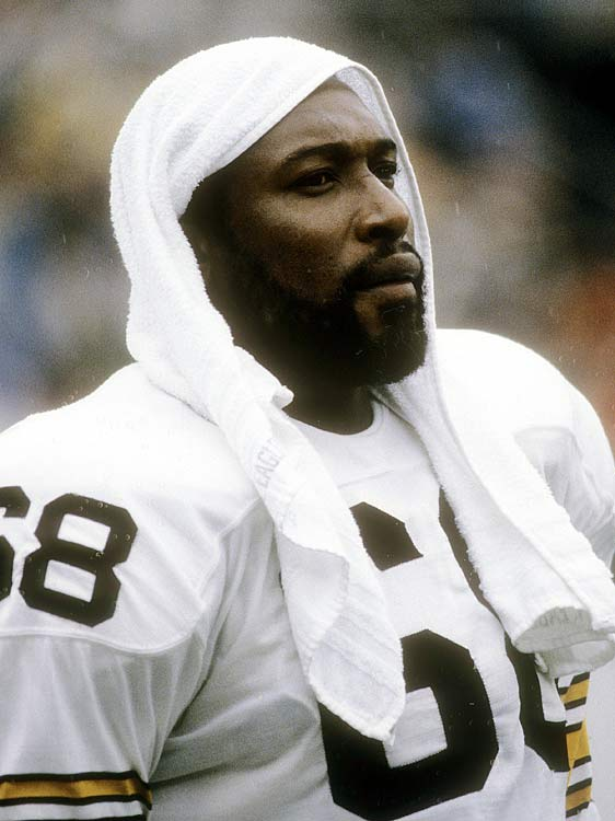 "A member of the famed ""Steel Curtain"" defense, Pittsburgh Steelers defensive end L.C. Greenwood towels off during a Nov. 9 game in Tampa Bay. Greenwood played 15 games for the Steelers in what would be his second-to-last season in his 13-year career."