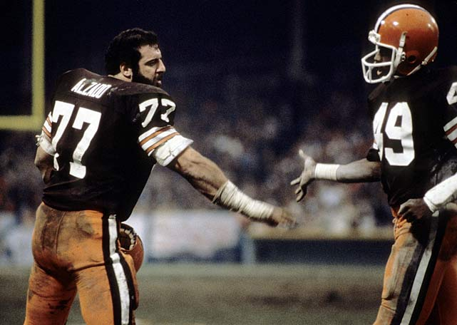 Cleveland Browns defensive end Lyle Alzado (77) congratulates defensive back Clinton Burrell during a Dec. 7 game against the New York Jets. Though their defense ranked 23rd in the NFL in yards allowed, the Browns won the AFC Central and made the playoffs for the first time since the 1972-73 season.