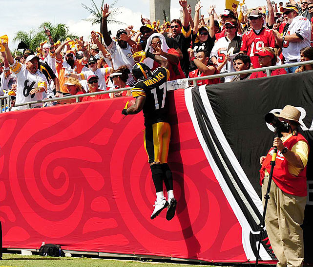 The fired-up Wallace leaps into the stands to cap off his second-quarter celebration.