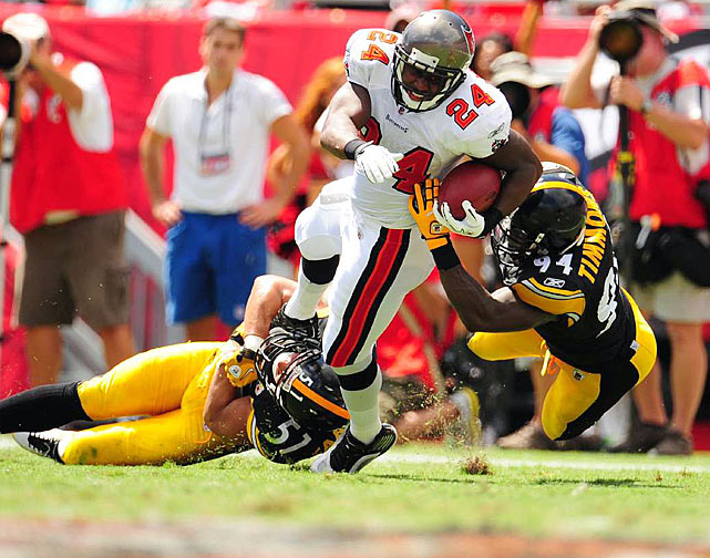 Tampa Bay running back Cadillac Williams is wrestled to the ground by Steelers linebackers James Farrior and Lawrence Timmons.  The Pittsburgh defense kept Williams in check, holding him to 13 rushing yards on a mere six carries.