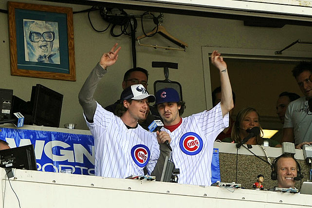 "It was only natural that, after winning the franchise's first Stanley Cup since 1961, the Blackhawks would turn up at Wrigley Field to serenade the Windy City faithful with renditions of ""Take Me Out to the Ballgame."" Captain Jon Toews and Patrick Kane did a version, but we prefer Bolland and Keith's more, um, challenging rendition.   Click here for video."