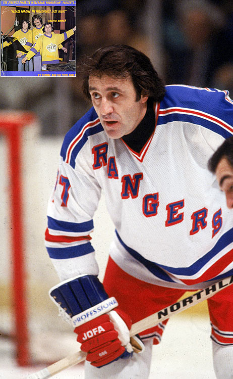 "Thanks to reader John Heberling of Universal City, Texas, for alerting to us to a musical milestone from 1979: Phil Esposito lending his dulcet tones to ""Hockey Sock Rock"" by the Rangers Rockers (Espo, Ron Duguay, Dave Maloney, Pat Hickey).   Click here to listen.   Not to be outdone, Marcel Dionne, Dave Taylor and Charlie Simmer of the Kings formed Dionne and The Puck-Tones and cranked out the touching love lament, ""Please Forgive My Misconduct Last Night."" Both songs were released on one boffo 45-rpm record, with the price of purchase going to charity."