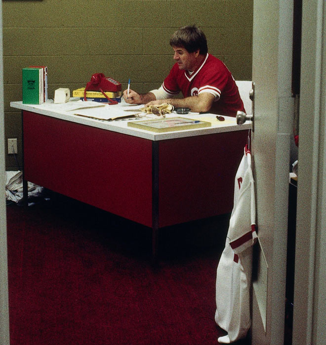 Rose takes notes before a Reds-Dodgers game at Riverfront Stadium.
