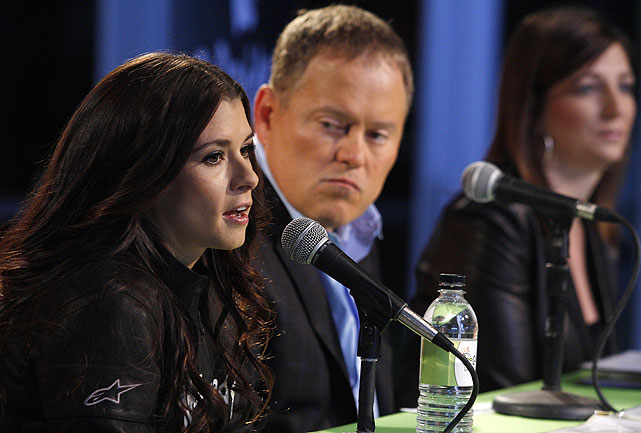 Danica Patrick, along with Go Daddy CEO Bob Parsons and JR Motorsports GM Kelly Earnhardt (background), announces her plan to compete in the Nationwide Series in 2010. She reached mid-September with two more races to go in the IndyCar season and seven more in Nationwide.