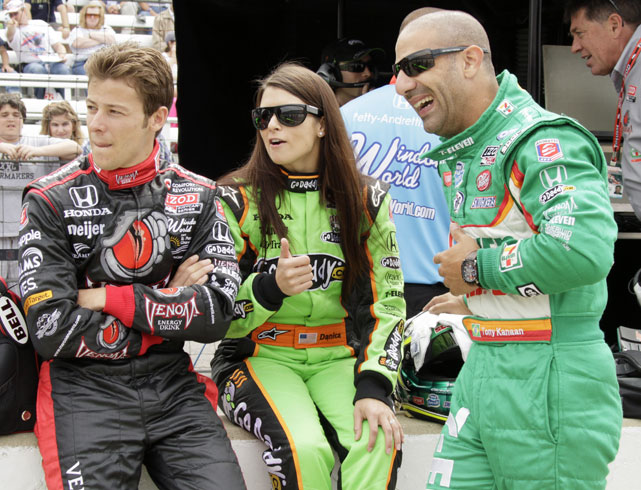 Marco Andretti, Danica Patrick and Tony Kanaan chat trackside during the opening day of practice for the Indy 500.