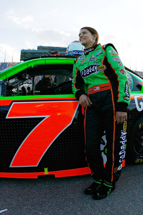 Danica stands beside her car before the Dollar General 300. Danica would earn a 24th-place finish at Michigan -- her best Nationwide result of the season.