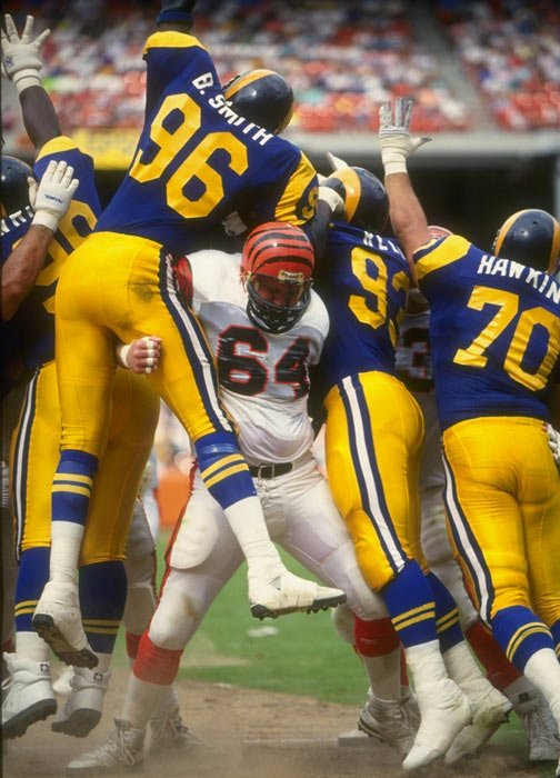 Bengals offensive lineman Bruce Kozerski does double-duty as he blocks Rams defenders Brian Smith and Doug Reed during a game at Anaheim Stadium.
