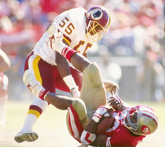 Washington linebacker Andre Collins tackles San Francisco running back Roger Craig during a game at Candlestick Park.