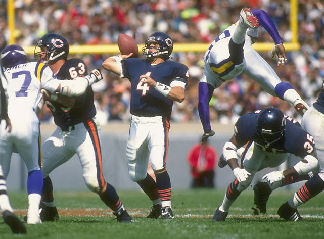 Bears running back Neal Anderson sends a Viking defender flying during Chicago's 19-16 victory at Soldier Field with Jim Harbaugh as quarterback.