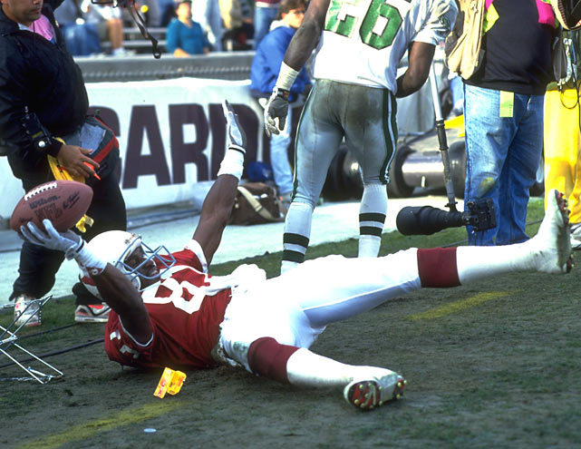 Cardinals wide receiver Roy Green celebrates after a touchdown against the Eagles.