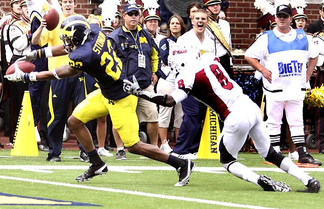 Michigan fell behind early, but two Darryl Stonum touchdowns just before the half put the Wolverines back on top. Michigan's shaky D let UMass get back in it, but Big Blue escaped.