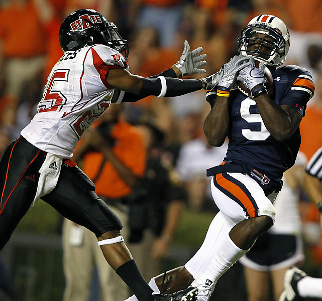 Quindarius Carr (right) hauls in a long touchdown pass as the Tigers got off to a good start. Auburn's Cameron Newton accounted for five touchdowns -- three passing and two rushing.