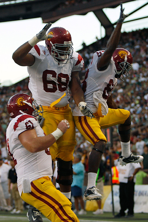 Southern California was able to get into mid-season form in some areas Thursday, like its touchdown celebrations. Matt Barkley and Ronald Johnson connected on three touchdowns to make Lane Kiffin a winner in his first game for the Trojans to start the post-Pete Carroll era. It wasn't all rosy, though, as USC allowed 588 yards.