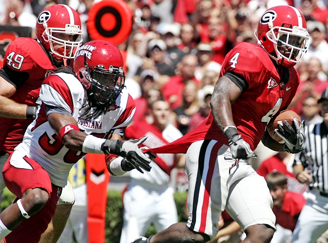 Despite the absences of top wide receiver A.J. Green and running back Washaun Ealey, Georgia cruised on offense. Tailback Caleb King (pictured) got the Dawgs on the board early, and freshman quarterback Aaron Murray passed for three touchdowns and ran for another in his first Georgia start.