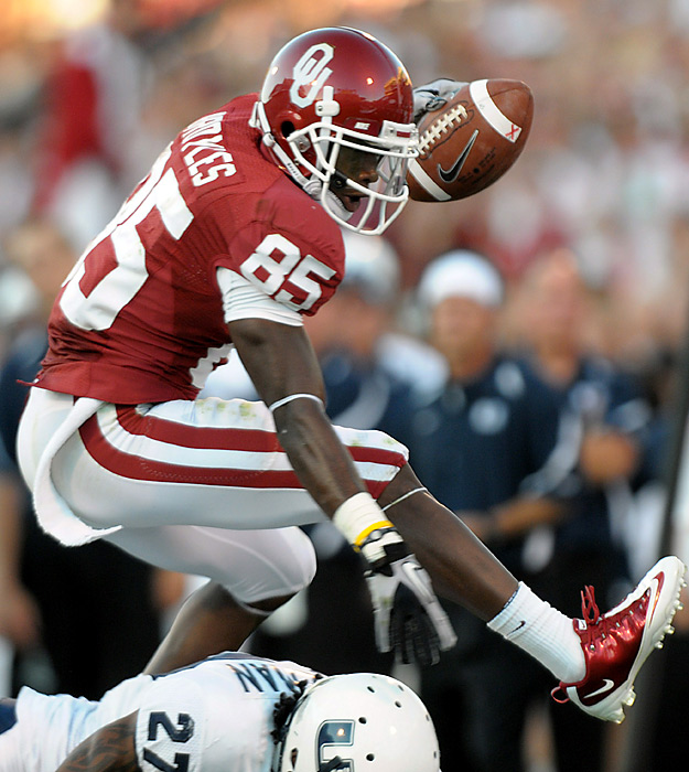 Wide receiver Ryan Broyles shows a little fancy footwork while negotiating the defense. Broyles hauled in nine passes for 139 yards and two touchdowns as the Sooners survived an unexpected scare. Jamell Fleming secured the 800th win in the program's history by intercepting Diondre Borel's pass in the final 5 minutes, dragging his feet to stay inbounds near the sideline. The Sooners are only the seventh Division I school to reach that mark, joining a handful of powerhouses including Michigan, Texas and Notre Dame.