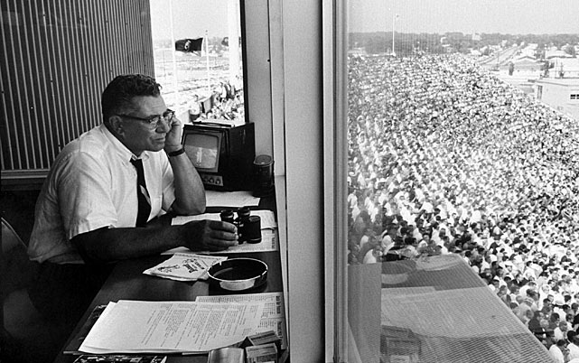 Lombardi in a coaching booth above the field.