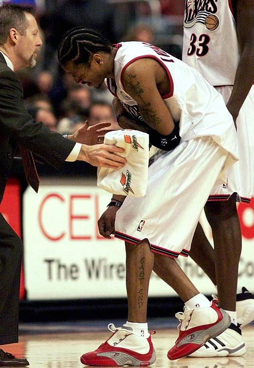 Iverson grasps his shoulder in pain while walking off the court during a December 2000 matchup with the New York Knicks. His arm was riddled with injuries throughout his prolific career, and many believe he started wearing a sleeve on his right arm to compensate for bursitis in his elbow. The sleeve soon became AI's distinctive look.